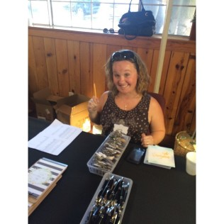 Suzie manning a registration table