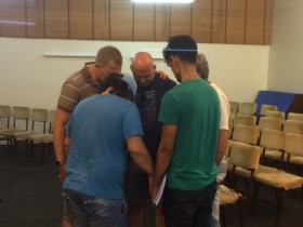 Matt & John praying with some people after our Seekers Study.