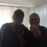 Van VanDeuson (CCBC Director of Affiliate Campuses) chowing down on Frank's birthday cinnamon rolls!