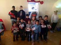 Kids receiving their Bibles and being prayed over...